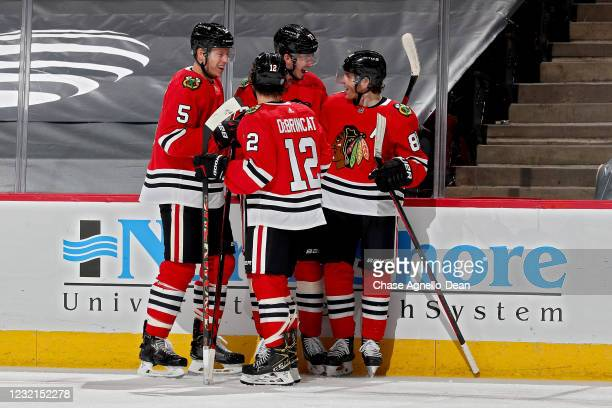 Kirby Dach of the Chicago Blackhawks celebrates with teammates after scoring a goal in the first period against the Dallas Stars at the United Center...