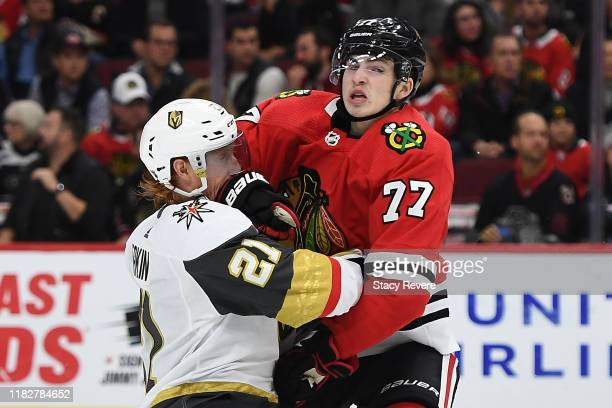 Kirby Dach of the Chicago Blackhawks collides with Cody Eakin of the Vegas Golden Knights during the third period at the United Center on October 22,...