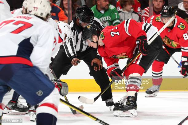 Kirby Dach of the Chicago Blackhawks faces off against the Washington Capitals in the second period at the United Center on October 20 2019 in...