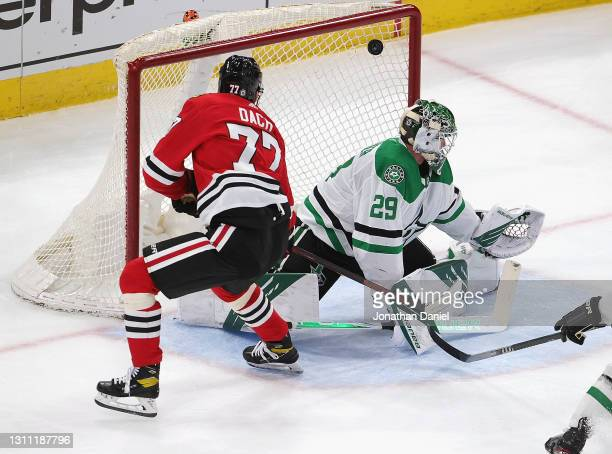 Kirby Dach of the Chicago Blackhawks scores his first goal of the season against Jake Oettinger of the Dallas Stars at the United Center on April 06,...