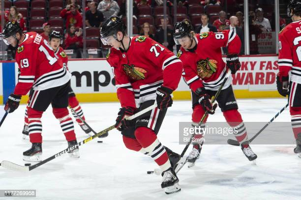 Kirby Dach of the Chicago Blackhawks warms up with teammates prior to the game against the Washington Capitals at the United Center on October 20...
