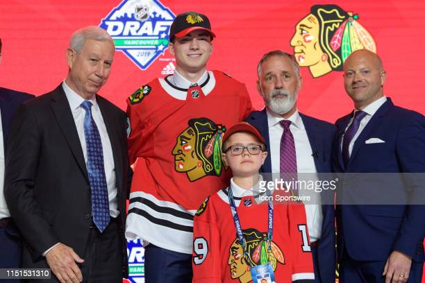 Kirby Dach poses for a photo onstage after being selected third overall by the Chicago Blackhawks during the first round of the 2019 NHL Draft at...