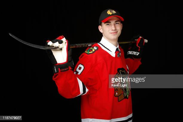 Kirby Dach poses for a portrait after being selected third overall by the Chicago Blackhawks during the first round of the 2019 NHL Draft at Rogers...