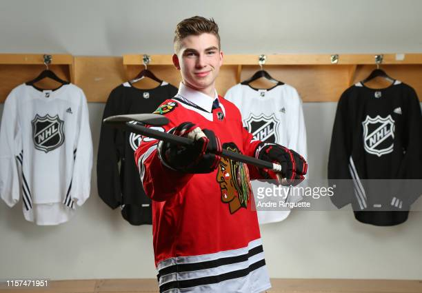 Kirby Dach third overall pick by the Chicago Blackhawks poses for a portrait during the first round of the 2019 NHL Draft at Rogers Arena on June 21...