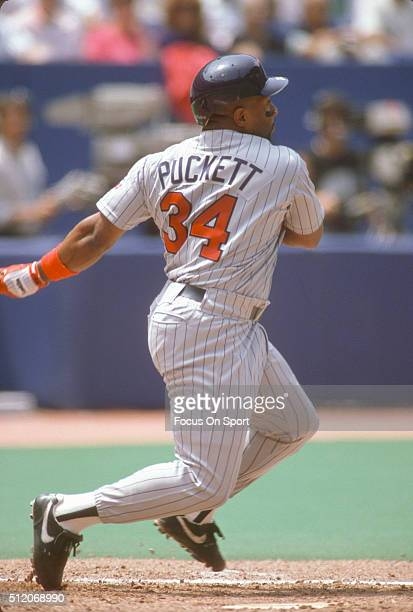 Kirby Puckett of the Minnesota Twins bats against the Toronto Blue Jays during a Major League Baseball game circa 1990 at Exhibition Stadium in...