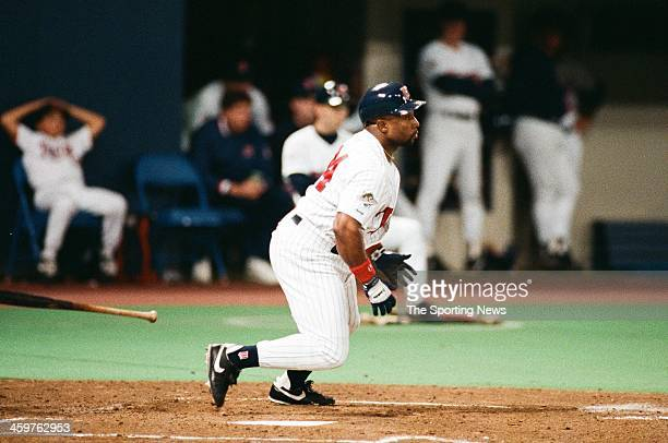 Kirby Puckett of the Minnesota Twins bats during a 1991 World Series game against the Atlanta Braves at the Hubert H Humphrey Metrodome in...