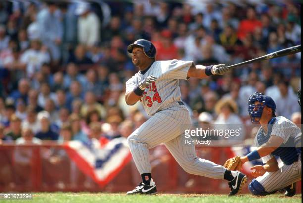 Kirby Puckett of the Minnesota Twins bats during an MLB game against the Milwaukee Brewers at County Stadium in Milwaukee Wisconsin during the 1988...