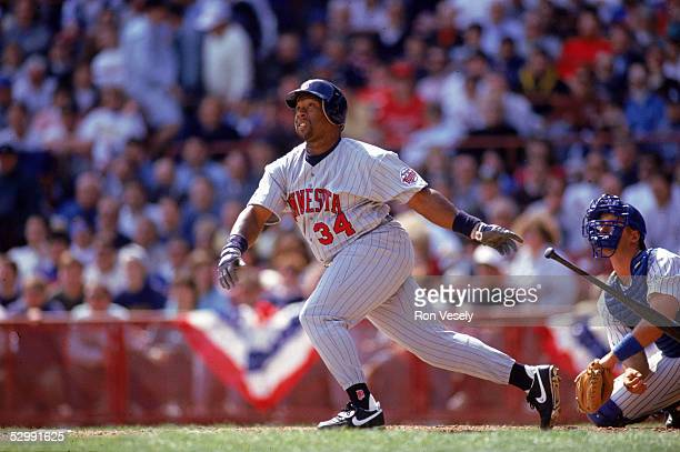 Kirby Puckett of the Minnesota Twins bats during an MLB game at Milwaukee County Stadium in Milwaukee Wisconsin Kirby Puckett played for the...