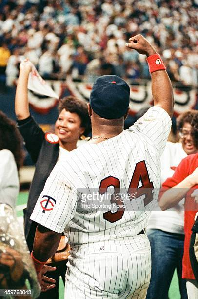 Kirby Puckett of the Minnesota Twins celebrates following a 1991 World Series game against the Atlanta Braves at the Hubert H Humphrey Metrodome in...