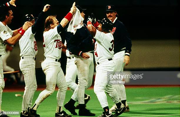 Kirby Puckett of the Minnesota Twins is high fived after scoring during World Series game six between the Atlanta Braves and Minnesota Twins on...