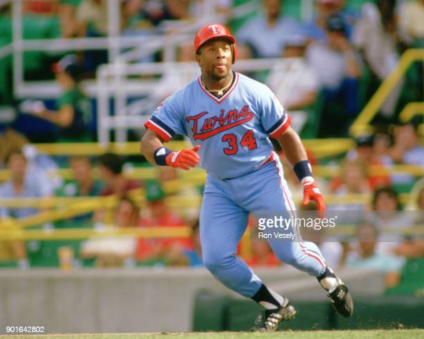 Kirby Puckett of the Minnesota Twins runs the bases during an MLB game versus the Chicago White Sox at Comiskey Park in Chicago Illinois during the...