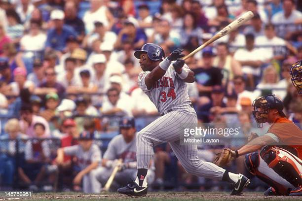 Kirby Puckett of the Minnesota Twins takes a swing during a baseball game against the Baltimore Orioles on September 1 1990 at Memorial Stadium in...