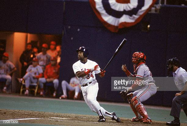 Kirby Puckett of the Minnesota Twins watches the flight of the ball as he follows through on his swing during a game in the 1987 World Series against...
