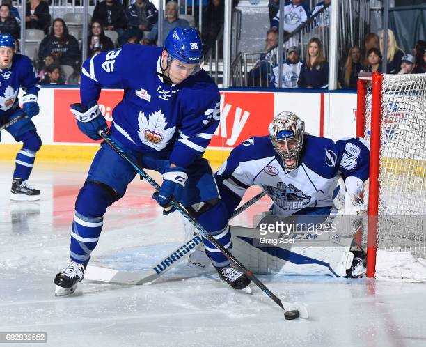 Kirby Rychel of the Toronto Marlies controls the puck in front of goalie Mike McKenna of the Syracuse Crunch during game 4 action in the Division...