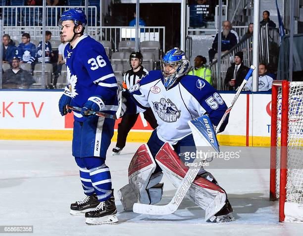 Kirby Rychel of the Toronto Marlies puts a screen on Mike McKenna of the Syracuse Crunch on March 26 2017 at Ricoh Coliseum in Toronto Ontario Canada