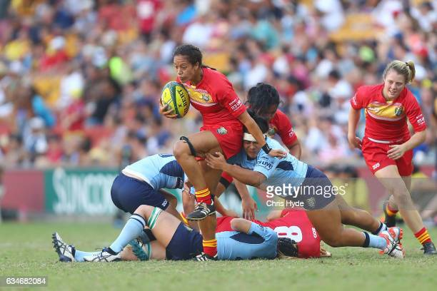 Kirby Sefo of QLD Womens runs the ball during the Rugby Global Tens match between QLD Womens and NSW Women at Suncorp Stadium on February 11 2017 in...