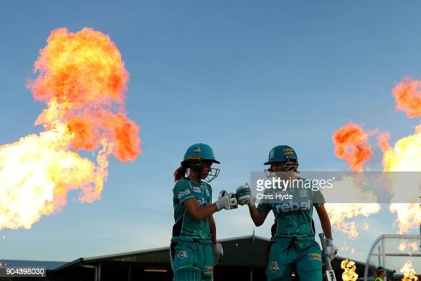KIrby Short and Beth Mooney of the Heat walk out for the Women's Big Bash League match between the Brisbane Heat and the Melbourne Stars on January...
