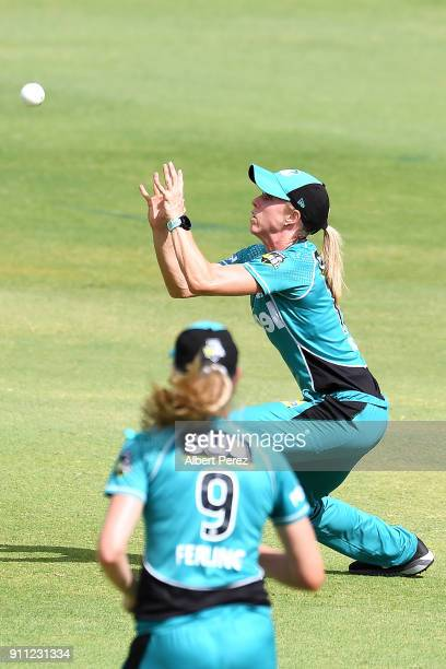 Kirby Short of the Heat catches Nicola Carey of the Thunder during the Women's Big Bash League match between the Sydney Thunder and the Brisbane Heat...