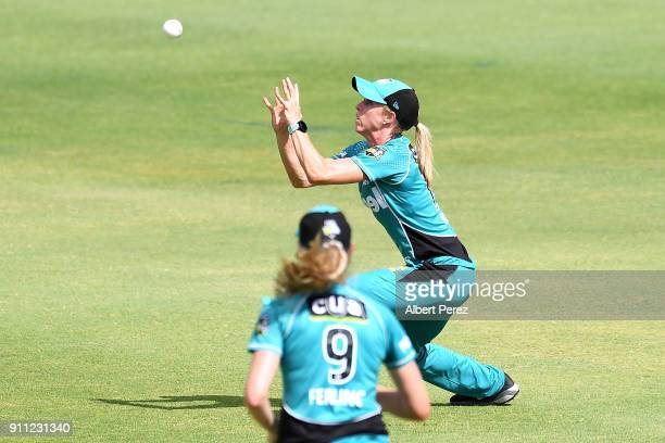Kirby Short of the Heat catches out Nicola Carey of the Thunder during the Women's Big Bash League match between the Sydney Thunder and the Brisbane...