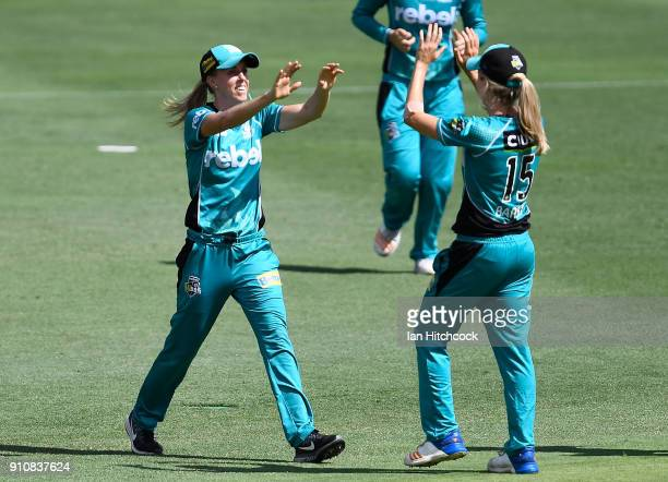 Kirby Short of the Heat celebrates with Jemma Barsby of the Heat after taking the catch to dismiss Nicola Carey of the Thunder during the Women's Big...