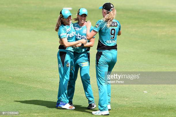 Kirby Short of the Heat celebrates with team mates after catching out Nicola Carey of the Thunder during the Women's Big Bash League match between...