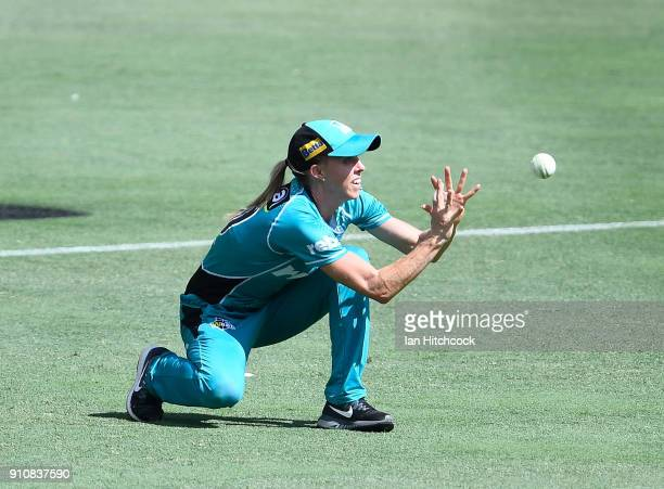 Kirby Short of the Heat takes the catch to dismiss Nicola Carey of the Thunder during the Women's Big Bash League match between the Brisbane Heat and...