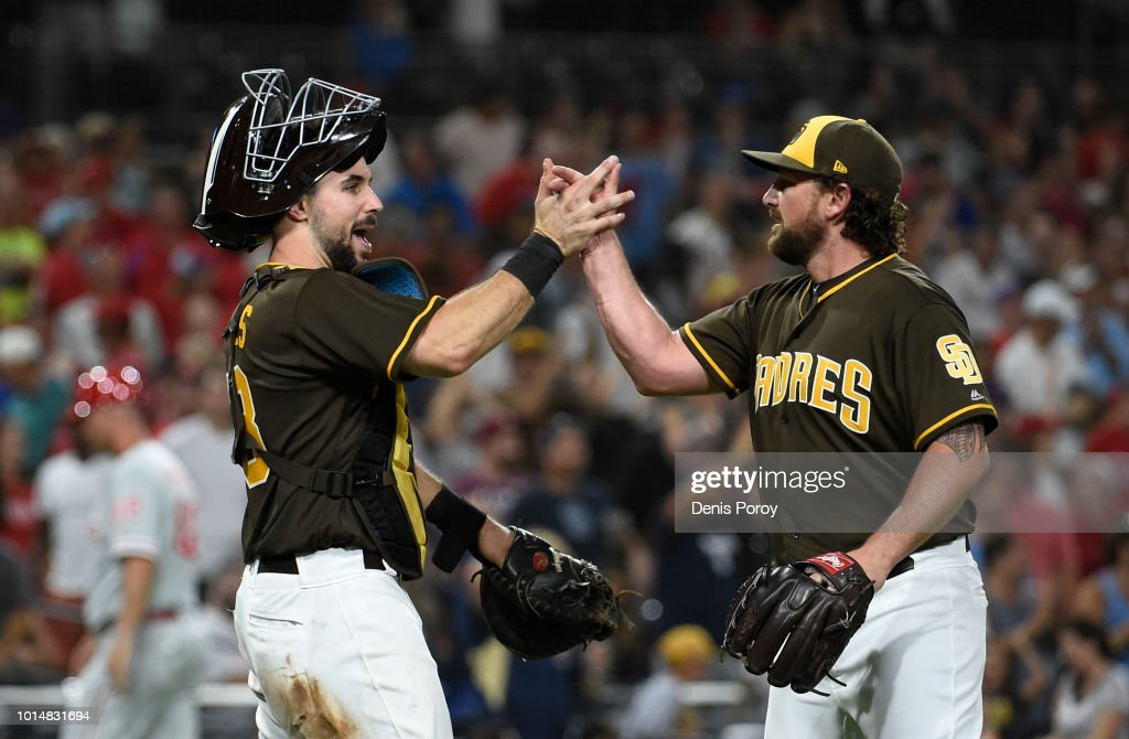 Kirby Yates #39 of the San Diego Padres is congratulated by Austin Hedges #18 of the San Diego Padres after beating the Philadelphia Phillies 2-0 in a baseball game at PETCO Park on August 10, 2018 in San Diego, California.