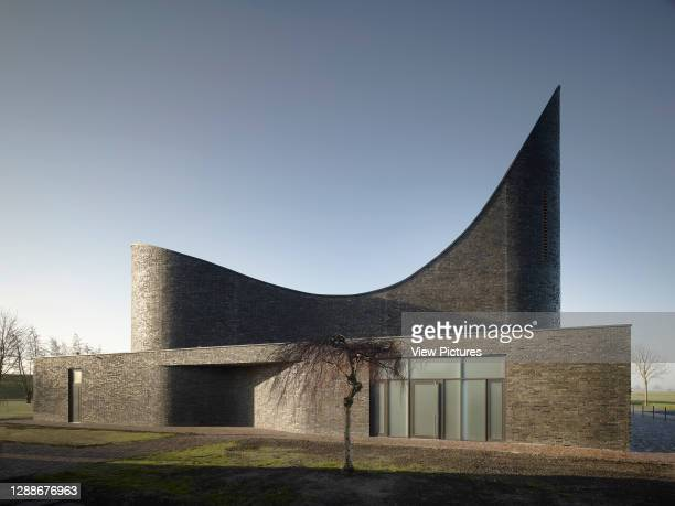 Kirche am Meer / Church by the Sea, Schillig, Germany. Architect: Koenigs Architekten, 2012. Side elevation with covered entrance and bell tower.