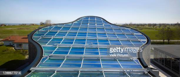 Kirche am Meer / Church by the Sea, Schillig, Germany. Architect: Koenigs Architekten, 2012. Panoramic glass roof detail with surrounding coastal...