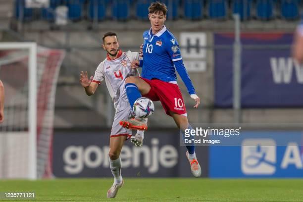 Kire Ristevski of North Macedonia and Noah Frick of Liechtenstein battle for the ball during the 2022 FIFA World Cup Qualifier match between...