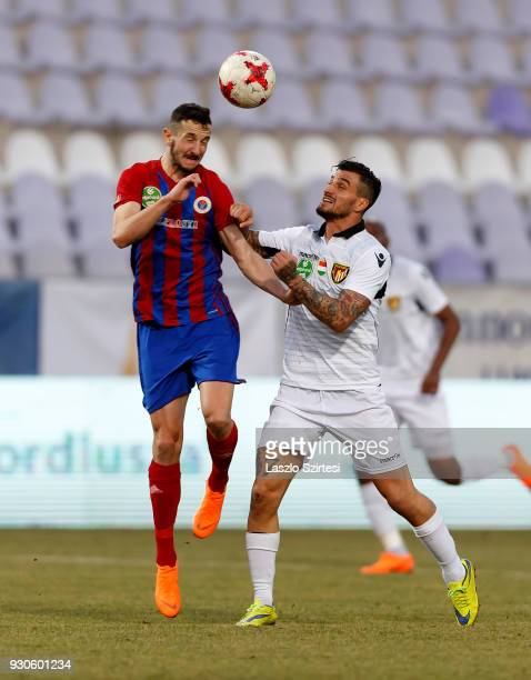Kire Ristevski of Vasas FC wins the ball in the air from Davide Lanzafame of Budapest Honved during the Hungarian OTP Bank Liga match between Vasas...