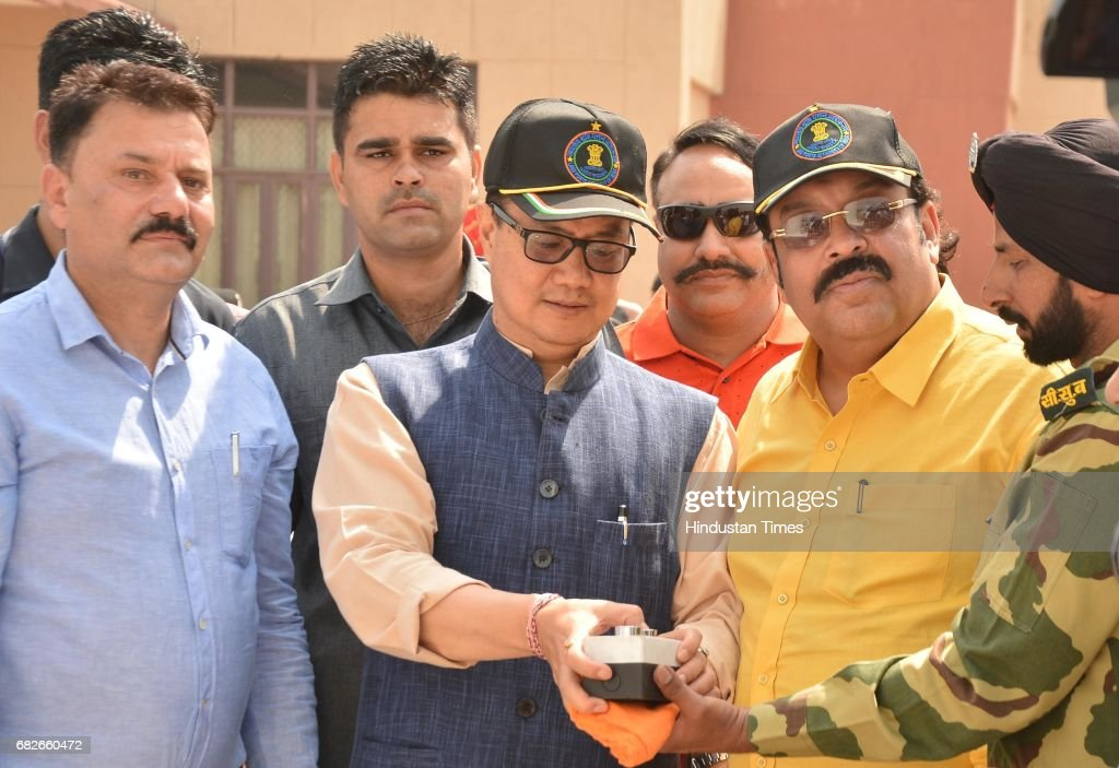 Kiren Rijiju Union Minister of State for Home Affairs along with Rajya Sabha MP Shwait Malik pushes a button to hoist the 107 feet high tricolour at..