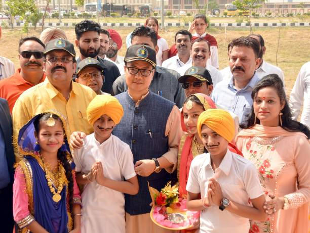 Kiren Rijiju Union Minister of State for Home Affairs along with Rajya Sabha MP Shwait Malik and others with school children during the inauguration..