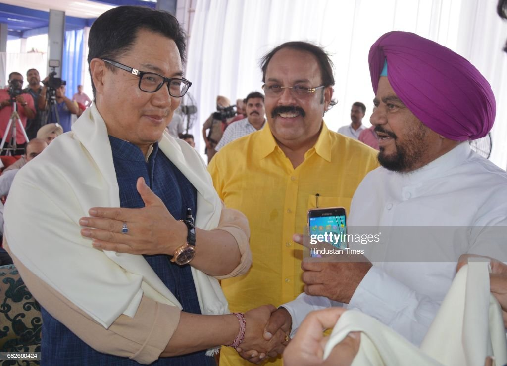 Kiren Rijiju Union Minister of State for Home Affairs shakes hand with Congress MLA Tarsem Singh DC during the inauguration of 107 feet high...
