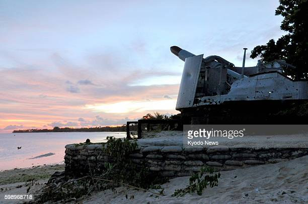 TARAWA Kiribati A revetment to prevent submergence is seen around the ruins of an 8inch cannon abandoned by the former Japanese military in Tarawa...