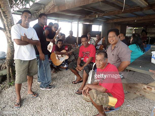 Kiribati fishermen Uein Buranibwe and Temaei Tontaake who survived a 33day drift on the ocean sit together after they arrived in Majuro on December...