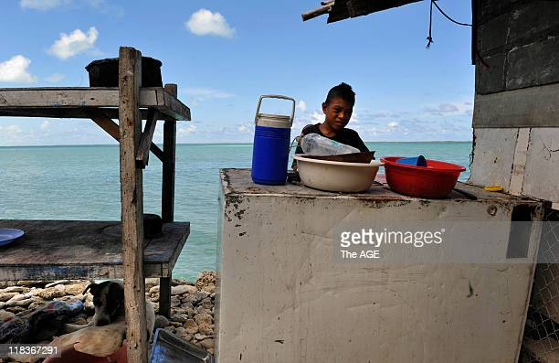 Kiribati Islands Climate Change A boy next to his home in the village of Abarao on the island of Tarawa