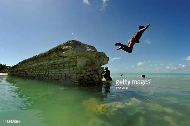 Kiribati Islands Climate Change A child jumps off a sea wall in the village of Eita on the island of Tarawa The sea wall has been destroyed by rising...