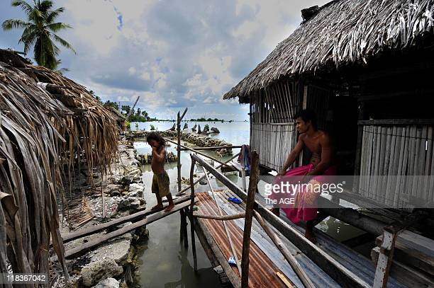 Kiribati Islands Climate Change A man and his daughter at home in the relocated village Tebunginako on the island of Abaiang His home used to be on a...