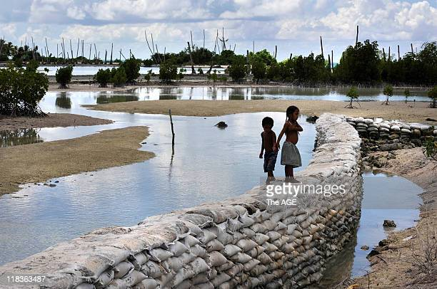 Kiribati Islands Climate Change A sea wall at low tide in the village of Tebunginako on the island of Abaiang The lagoon used to consist of fresh...