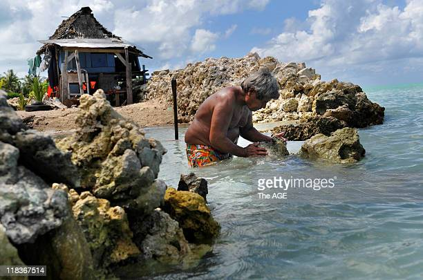 Kiribati Islands Climate Change Albert Ientau rebuilding his sea wall to protect his home in the village of Abarao on the island of Tarawa