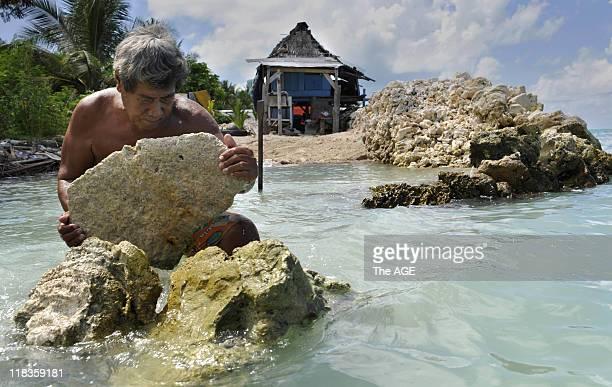 Kiribati Islands Climate Change Albert Ientau rebuilds his sea wall to protect his home in the village of Abarao on the island of Tarawa