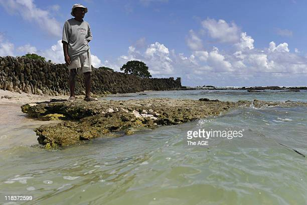 Kiribati Islands Climate Change Kirarenti Muller in front of the sea wall protecting his home in the village of Temwaiku on the island of Tarawa