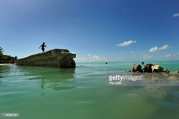 Kiribati Islands Climate Change The sea wall in the village of Eitaon the island of Tarawa has been destroyed by rising tides