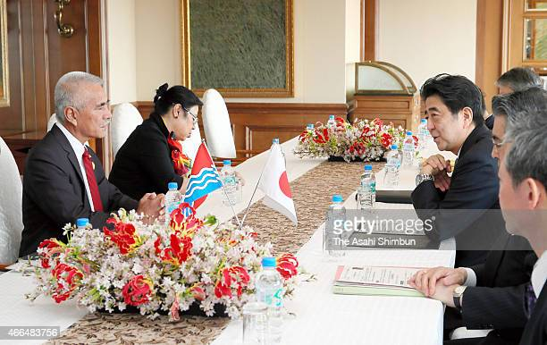 Kiribati President Anote Tong and Japanese Prime Minister Shinzo Abe talk during their meeting on the sidelines of the UN World Conference on...