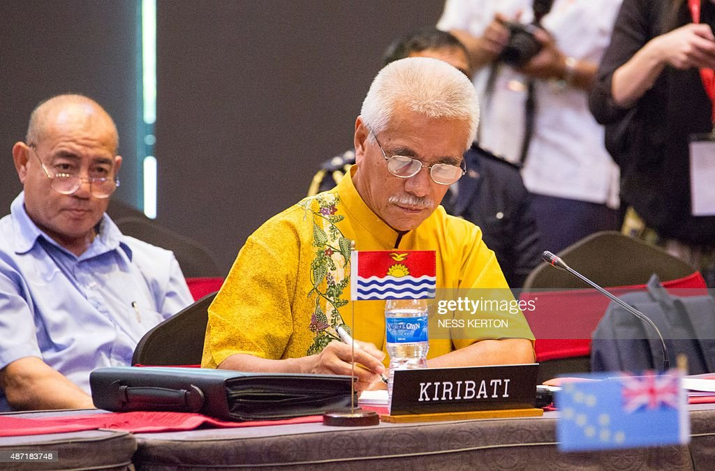 Kiribati President Anote Tong (C) listens to a speaker during the Smaller Islands States Leaders meeting as part of the Pacific Islands Forum in Port Moresby, Papua New Guinea, on September 7, 2015. Vulnerable Pacific island nations will this week send the world an urgent plea for action on climate change at crunch talks in Paris later this year. Some Pacific Islands Forum (PIF) countries lie barely a metre (three feet) above sea level and fear they will disappear beneath the waves without drastic intervention from major polluters. AFP PHOTO / Ness KERTON