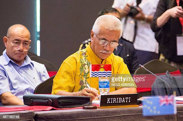 Kiribati President Anote Tong listens to a speaker during the Smaller Islands States Leaders meeting as part of the Pacific Islands Forum in Port...