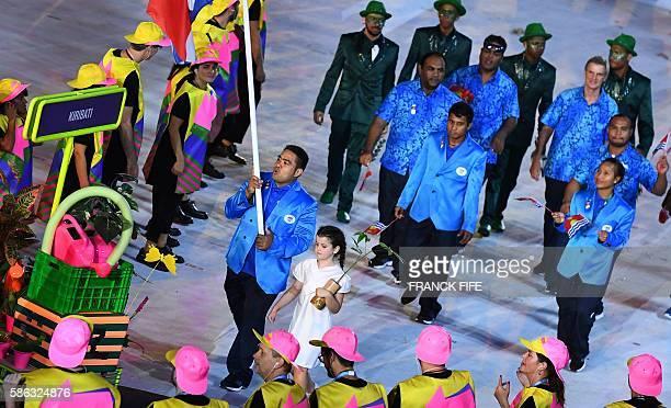 Kiribati's flag bearer David Katoatau leads his national delegation during the opening ceremony of the Rio 2016 Olympic Games at the Maracana stadium...