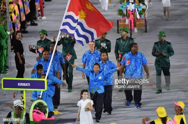 Kiribati's flagbearer David Katoatau leads his delegation during the opening ceremony of the Rio 2016 Olympic Games at the Maracana stadium in Rio de...