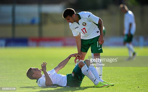 Kiril Despodov of Bulgaria cuts a dejected figure as Dimitar Velkovski of Bulgaria attempts to help during the Toulon Tournament match between...